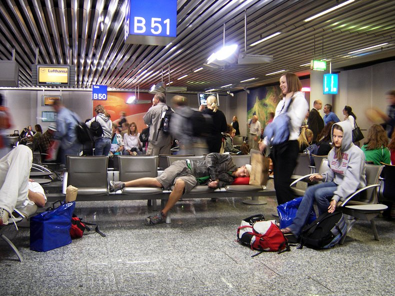 trying to sleep in airport - travel planning