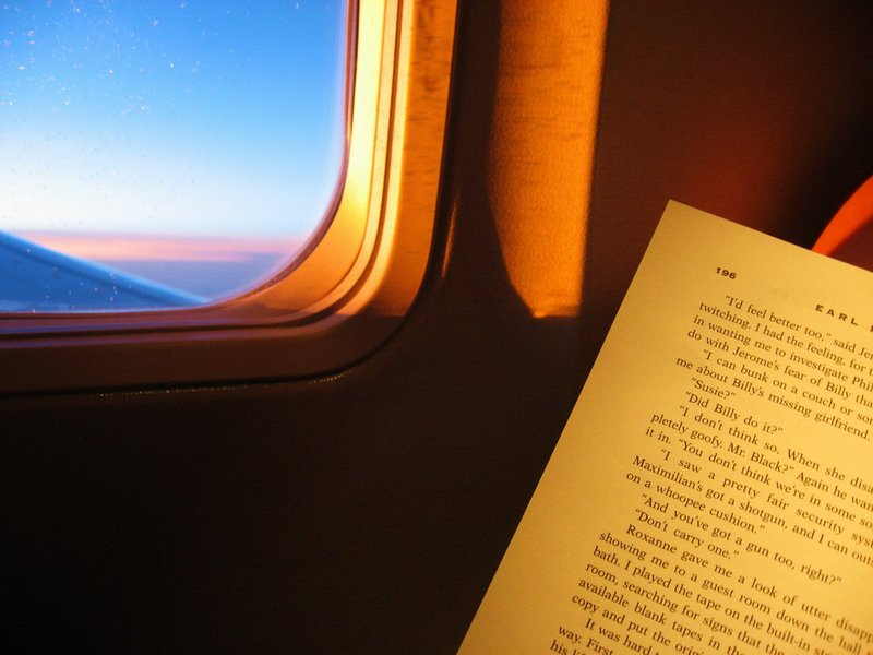Reading Book On Airplane - travel planning